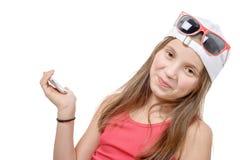 Het portret van a preteen meisje met een telefoon Royalty-vrije Stock Foto