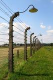 Het prikkeldraadomheining van Auschwitz stock fotografie