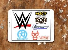 Het professionele worstelen toont en federatiesemblemen en pictogrammen zoals wwe, nxt Stock Foto's