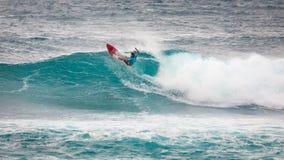 Het prostrand Hawaï van de Surferzonsondergang stock afbeelding