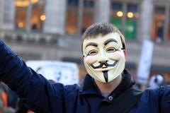 Het protest van anti-handelingen met Anoniem masker in Amsterdam Stock Foto's