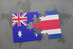 het raadsel met de nationale vlag van Australië en Costa Rica op een wereld brengen achtergrond in kaart Royalty-vrije Stock Foto's