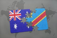 het raadsel met de nationale vlag van Australië en de democratische republiek van de Kongo op een wereld brengen achtergrond in k Royalty-vrije Stock Foto's