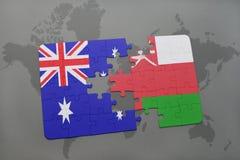 het raadsel met de nationale vlag van Australië en Oman op een wereld brengen achtergrond in kaart Stock Foto's