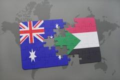 het raadsel met de nationale vlag van Australië en de Soedan op een wereld brengen achtergrond in kaart Stock Foto's