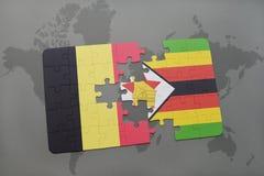 het raadsel met de nationale vlag van België en Zimbabwe op een wereld brengen achtergrond in kaart Royalty-vrije Stock Foto