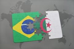 het raadsel met de nationale vlag van Brazilië en Algerije op een wereld brengen achtergrond in kaart Royalty-vrije Stock Foto