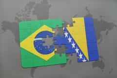 het raadsel met de nationale vlag van Brazilië en Bosnië-Herzegovina op een wereld brengen achtergrond in kaart Royalty-vrije Stock Foto