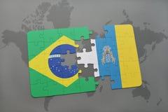 het raadsel met de nationale vlag van Brazilië en de Canarische Eilanden op een wereld brengen achtergrond in kaart Stock Foto