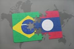 het raadsel met de nationale vlag van Brazilië en Laos op een wereld brengen achtergrond in kaart Royalty-vrije Stock Foto's