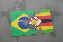 het raadsel met de nationale vlag van Brazilië en Zimbabwe op een wereld brengen achtergrond in kaart Stock Foto's