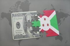 het raadsel met de nationale vlag van Burundi en het dollarbankbiljet op een wereld brengen achtergrond in kaart Stock Afbeeldingen