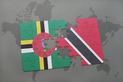 het raadsel met de nationale vlag van dominica en Trinidad en Tobago op een wereld brengen achtergrond in kaart Royalty-vrije Stock Afbeelding