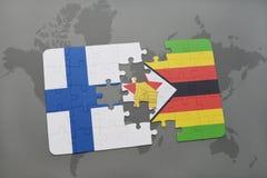 het raadsel met de nationale vlag van Finland en Zimbabwe op een wereld brengen achtergrond in kaart Royalty-vrije Stock Foto's