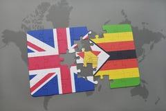 het raadsel met de nationale vlag van Groot-Brittannië en Zimbabwe op een wereld brengen achtergrond in kaart Royalty-vrije Stock Afbeeldingen