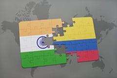 het raadsel met de nationale vlag van India en Colombia op een wereld brengen achtergrond in kaart Stock Foto