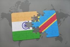 het raadsel met de nationale vlag van India en de democratische republiek van de Kongo op een wereld brengen achtergrond in kaart Stock Fotografie