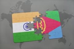 het raadsel met de nationale vlag van India en Eritrea op een wereld brengen achtergrond in kaart Royalty-vrije Stock Foto