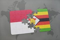 het raadsel met de nationale vlag van Indonesië en Zimbabwe op een wereld brengen achtergrond in kaart Stock Foto's