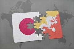 het raadsel met de nationale vlag van Japan en bhutan op een wereld brengen achtergrond in kaart Stock Fotografie