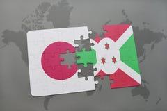 het raadsel met de nationale vlag van Japan en Burundi op een wereld brengen achtergrond in kaart Royalty-vrije Stock Foto