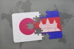 het raadsel met de nationale vlag van Japan en Kambodja op een wereld brengen achtergrond in kaart Royalty-vrije Stock Fotografie