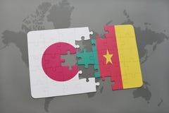 het raadsel met de nationale vlag van Japan en Kameroen op een wereld brengen achtergrond in kaart Royalty-vrije Stock Foto