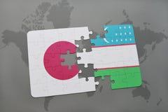 het raadsel met de nationale vlag van Japan en Oezbekistan op een wereld brengen achtergrond in kaart Stock Foto