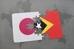 het raadsel met de nationale vlag van Japan en Oost-Timor op een wereld brengen achtergrond in kaart Royalty-vrije Stock Fotografie