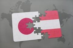 het raadsel met de nationale vlag van Japan en Oostenrijk op een wereld brengen achtergrond in kaart Royalty-vrije Stock Afbeeldingen