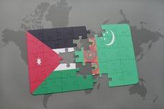 het raadsel met de nationale vlag van Jordanië en turkmenistan op een wereld brengen achtergrond in kaart Royalty-vrije Stock Afbeeldingen