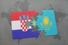 het raadsel met de nationale vlag van Kroatië en Kazachstan op een wereld brengen achtergrond in kaart Royalty-vrije Stock Foto