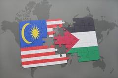 het raadsel met de nationale vlag van Maleisië en Palestina op een wereld brengen achtergrond in kaart Royalty-vrije Stock Foto