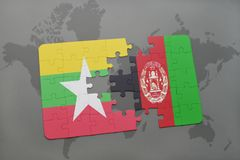 het raadsel met de nationale vlag van myanmar en Afghanistan op een wereld brengen achtergrond in kaart Royalty-vrije Stock Foto's