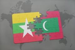 het raadsel met de nationale vlag van myanmar en de Maldiven op een wereld brengen achtergrond in kaart Royalty-vrije Stock Foto's