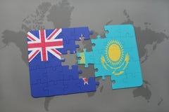 het raadsel met de nationale vlag van Nieuw Zeeland en Kazachstan op een wereld brengen achtergrond in kaart Royalty-vrije Stock Afbeeldingen