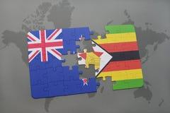 het raadsel met de nationale vlag van Nieuw Zeeland en Zimbabwe op een wereld brengen achtergrond in kaart Stock Foto