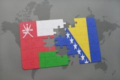 het raadsel met de nationale vlag van Oman en Bosnië-Herzegovina op een wereld brengen achtergrond in kaart Stock Foto