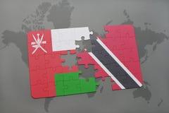 het raadsel met de nationale vlag van Oman en Trinidad en Tobago op een wereld brengen achtergrond in kaart Royalty-vrije Stock Foto