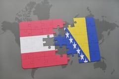 het raadsel met de nationale vlag van Oostenrijk en Bosnië-Herzegovina op een wereld brengen achtergrond in kaart Royalty-vrije Stock Foto