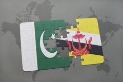 het raadsel met de nationale vlag van Pakistan en Brunei op een wereld brengen achtergrond in kaart Royalty-vrije Stock Fotografie