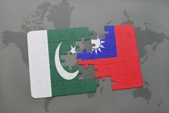 het raadsel met de nationale vlag van Pakistan en Taiwan op een wereld brengen achtergrond in kaart Royalty-vrije Stock Foto