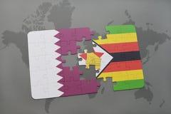 het raadsel met de nationale vlag van Qatar en Zimbabwe op een wereld brengen achtergrond in kaart Royalty-vrije Stock Fotografie