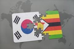 het raadsel met de nationale vlag van Zuid-Korea en Zimbabwe op een wereld brengen achtergrond in kaart Stock Foto's