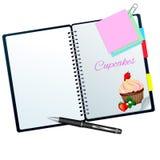 Het receptenboek ilustrated met aardbei cupcake Stock Afbeeldingen