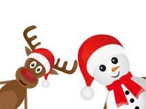 Het rendier van Kerstmis en een sneeuwman Stock Foto