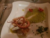 Het restaurant van Milaan van octopustomaten stock afbeeldingen