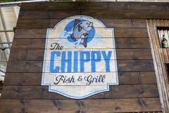Het restaurantteken van Chippy Fish en van de Grill stock foto's