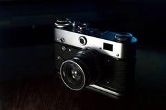 Het retrocamerapictogram van de fotocamera stock foto's