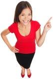 Het richten tonend vrouw vrolijk glimlachen stock afbeeldingen